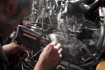 Close-up of mechanic soldering