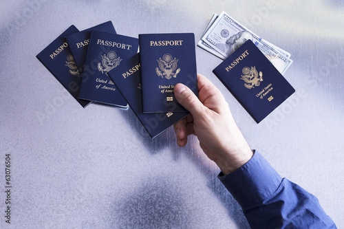 Man sorting and checking US passports