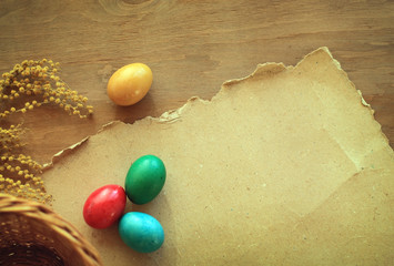 Easter eggs on vintage wooden paper background