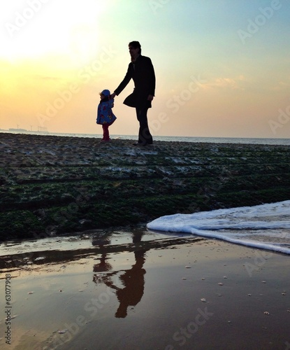 father and child ar seaside