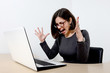 Young beautiful stressed businesswoman screaming at laptop