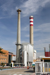 Tall smokestacks in a factory