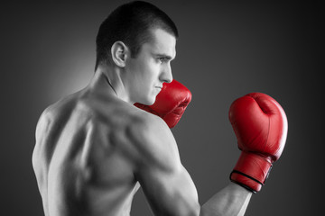 Boxing. Black and white fighter with red gloves.