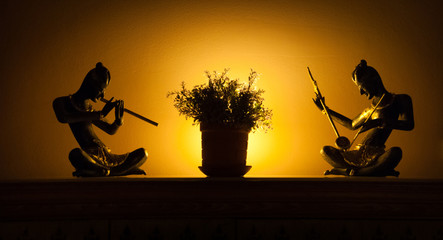 Statues of musicians in backlight