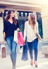 Beautiful girls with shopping bags