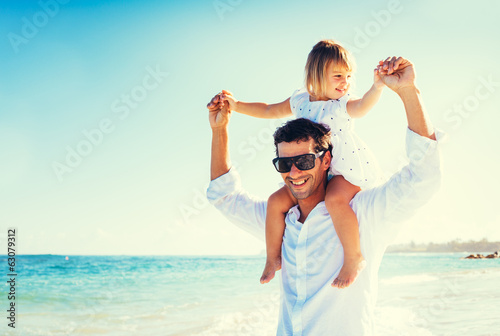 canvas print picture Father and Daughter at the Beach