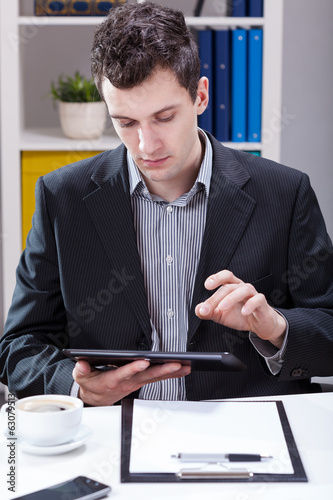 Businessman working on tablet