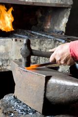 Blacksmith Hammering A Steel