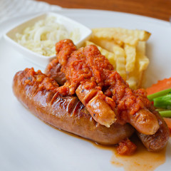 sausage platter with fried potato and vegetable