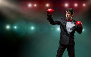 businessman with boxing gloves in the ring