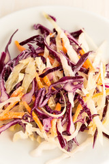 Healthy coleslaw with green, red cabbage and carrot
