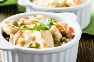 Chicken stew with carrrot and green peas in a creamy sauce