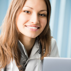Cheerful female doctor with laptop
