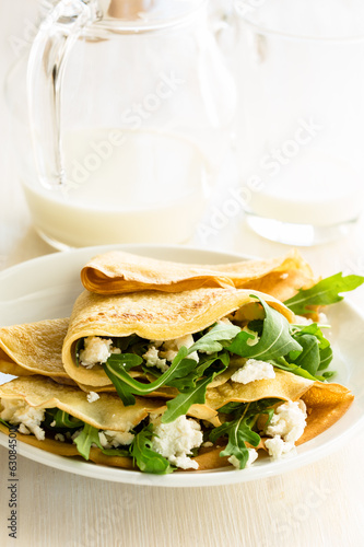 Arugula salad and cheese crepes