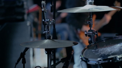 Musician playing drums at concert
