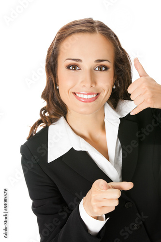 Businesswoman with call me gesture, on white