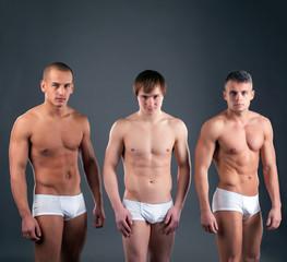 Sexy muscular guys advertises briefs in studio