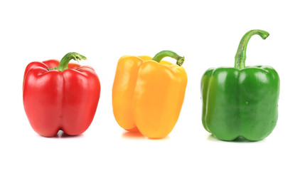 Colored peppers over white background.