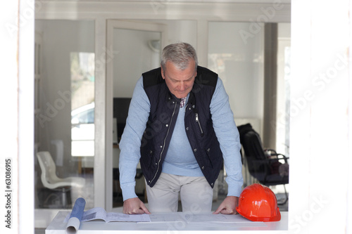 Senior architect standing in studio