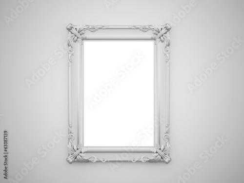 Vintage mirror with silver frame on the wall