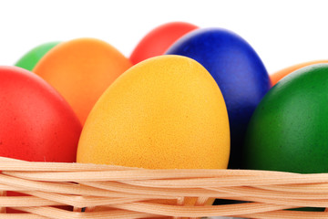 Colorful Easter eggs in basket.