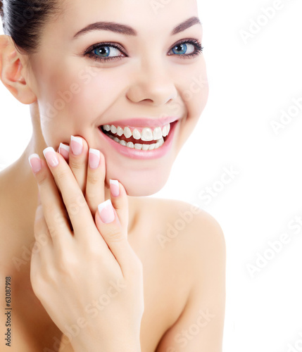 Cheerful female with fresh clear skin, white background