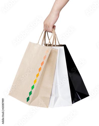 Woman hand holding paper shopping bags isolated