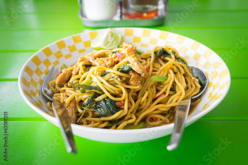 stir fried yellow noodles with basil leaf, chili and pork