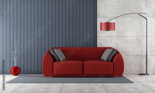 Contemporary living room with red couch