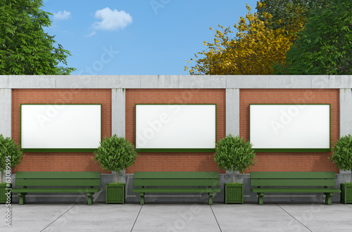 Blank street billboard on brick and concrete wall
