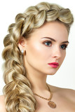 Portrait of young blonde woman with fishtail hair-dress poster