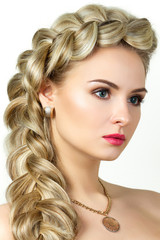 Portrait of young blonde woman with fishtail hair-dress
