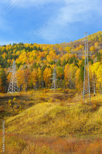 Power line supports in the Ural mountains in autumn