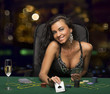 Leinwanddruck Bild - brunette girl in the casino playing poker, shows a playing card