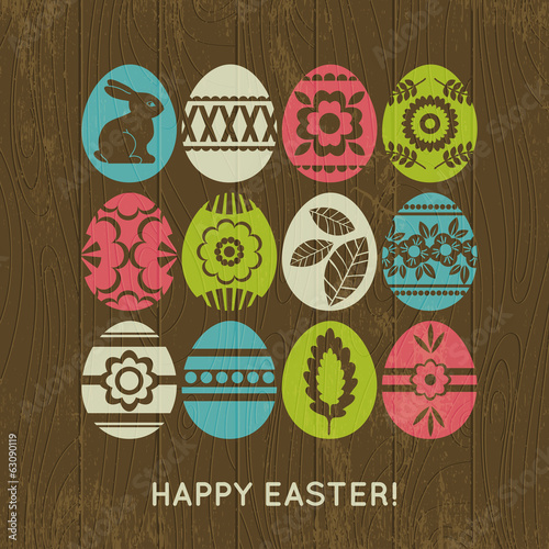 wooden background with color easter eggs, vector