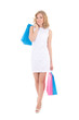 beautiful woman in white dress with shopping bags isolated on wh
