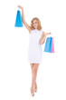 beautiful girl in white dress with shopping bags isolated on whi
