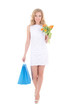 portrait of attractive girl with shopping bags and flowers isola