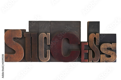 success, word written in vintage printing blocks