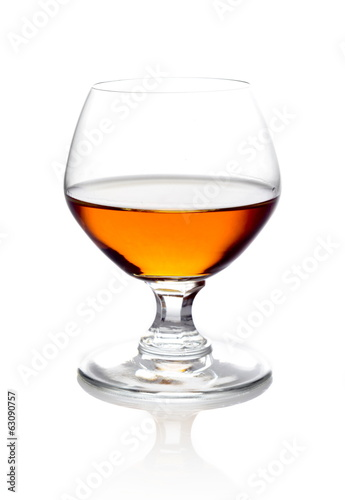Single glass of cognac isolated on white