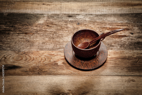 Wooden cup on old wooden table