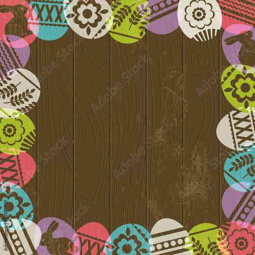 wooden background with frame of easter eggs