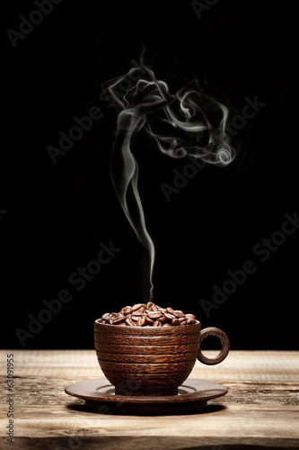 Fotobehang Koffiebonen Wooden cup with beans and woman-shaped smoke
