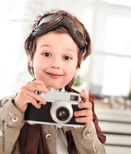 happy boy with retro camera