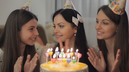 Birthday girl blows out the candles on the cake Full HD 1080 NTS