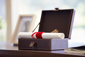 Documents And Letters In Keepsake Box On Desk