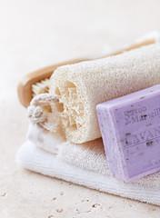 Organic Bath Accessories on a Travertine Background