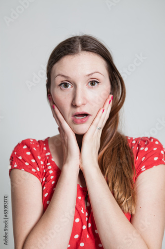 Surprised looking attractive woman