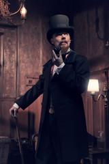 Vintage 1900 fashion man with beard. Smoking tobacco pipe. Stand