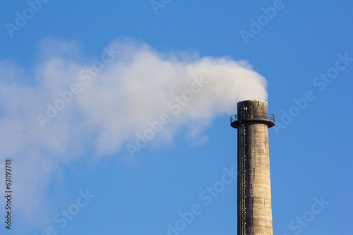 Industrial smoke chimney on blue sky